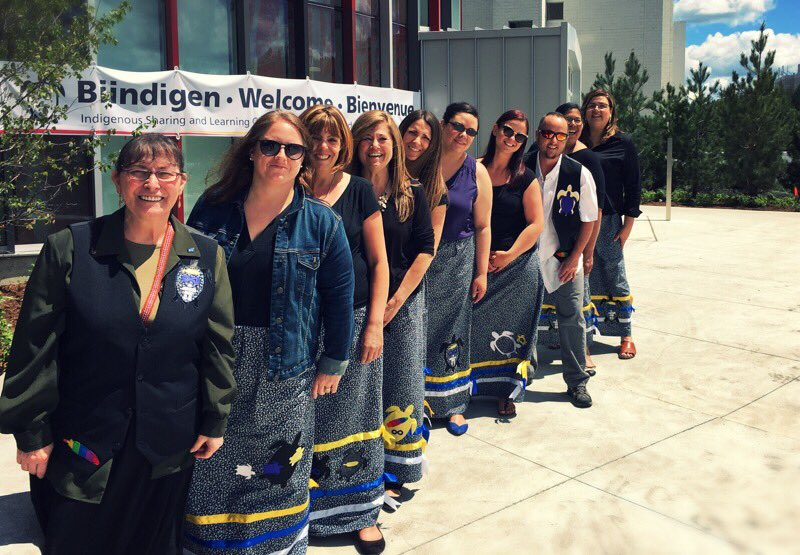 Staff of the Indigenous Student Affairs stand in front of the new Indigenous Learning Centre.