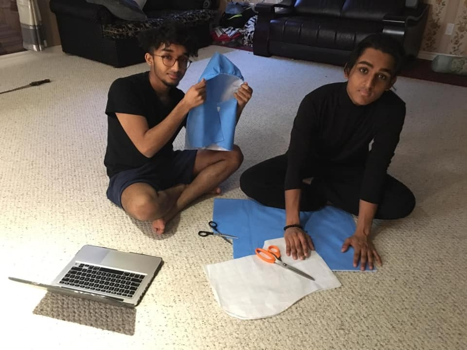 Hamza and Irbaaz Syed making gear to help protect healthcare workers.